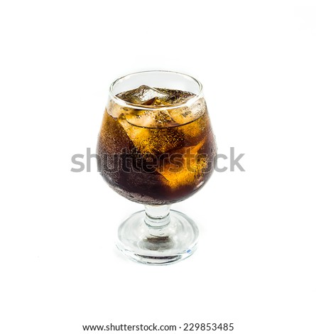 Cola with ice in glass on white background - stock photo