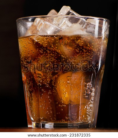 cola with ice . Selective focus