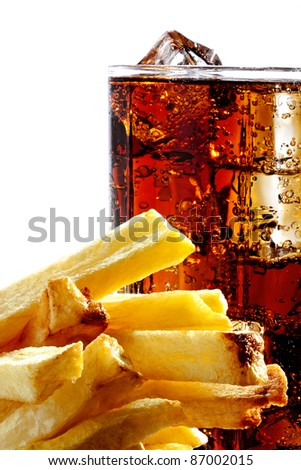 Cola with the ice in a glass and deep-fried potatoes, white background - stock photo