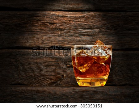 Cola with whiskey on wooden background with copy space - stock photo