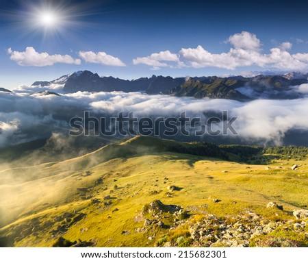 Colac mountain range at foggy summer morning. Dolomites mountains, Italy, Europe. - stock photo