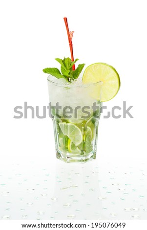 Cold alcoholic cocktail. Glass with drink stands on the surface covered with water drops - stock photo