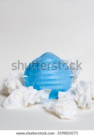 Cold and flu sickness theme with face mask and tissues - stock photo