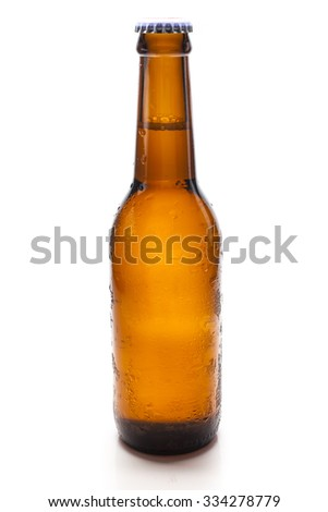 Cold beer bottle on white background. - stock photo