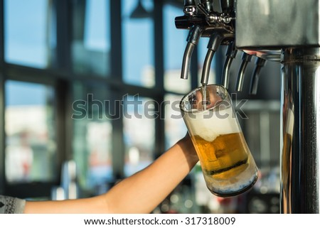 Cold Beer from tap in the afternoon time - stock photo