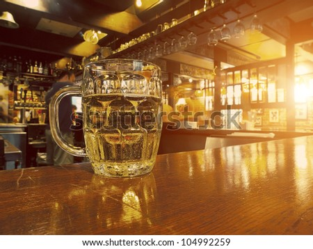 Cold Beer in a Pub Counter - stock photo