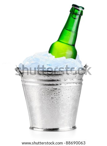 Cold beer in ice - stock photo