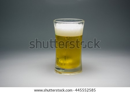 Cold beer in long glass