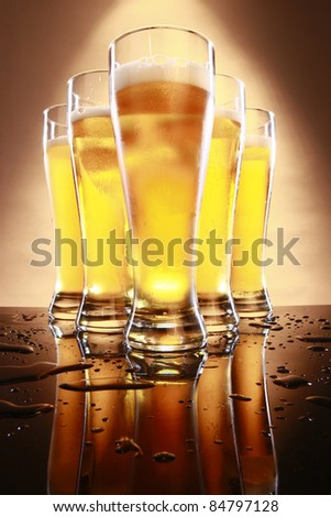 Cold beer in tall glasses - stock photo