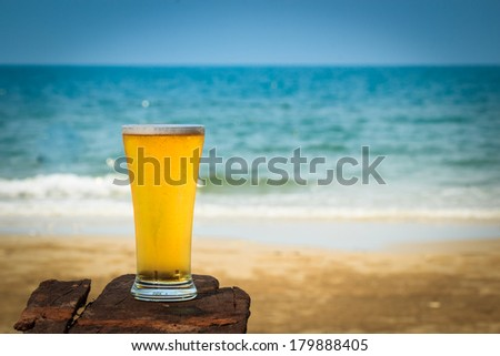 Cold beer on wooden  in front the sea of Thailand - stock photo