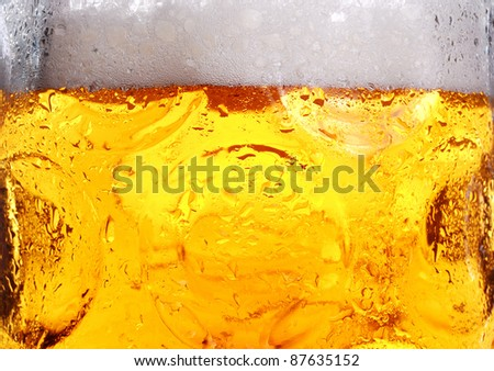 cold beer with suds in glass - stock photo