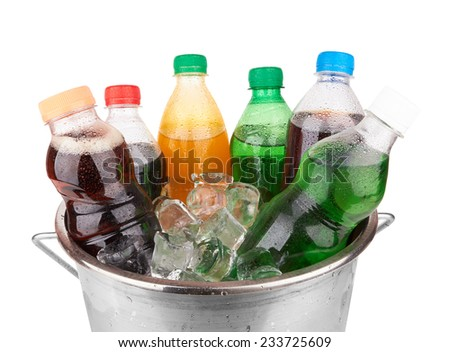 cold beverages in plastic  bottles on heap of ice cubes - stock photo