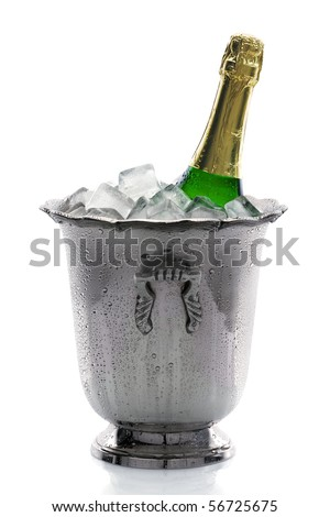 Cold bottle of champagne on ice with white background - stock photo