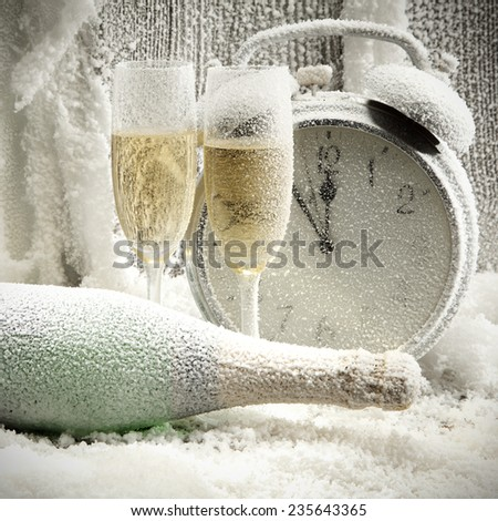cold champagne and clock on window sill  - stock photo