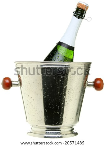 Cold champagne bottle in a silver ice bucket