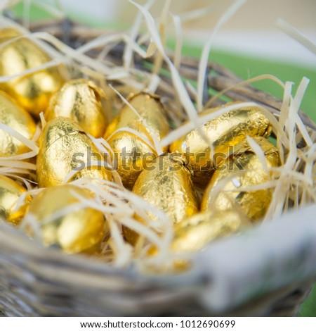 Cold chocolate easter eggs in a nice rustic basket close up