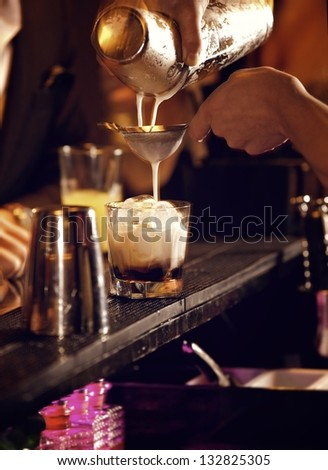 Cold cocktail drink being prepared  by the bartender - stock photo