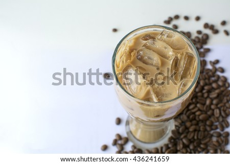 cold coffee drink and coffee beans on white background