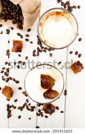 Cold coffee drink with ice and splashes - stock photo