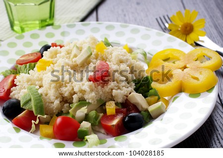 Cold couscous with sweet pepper and avocado - stock photo
