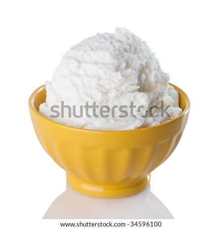 Cold, creamy vanilla ice cream in a bright, yellow bowl