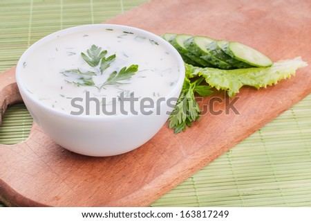 cold cucumber soup with slices of cucumber and mint