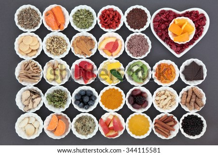 Cold cure and flu remedy food with health foods high in antioxidants and vitamin c with supplement capsules and medicinal herbs. - stock photo