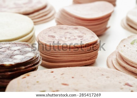 Cold cuts, slices, kind of sausages - stock photo