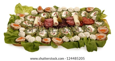 Cold dish mixed salad decorated with green rolls, lettuce and cheese