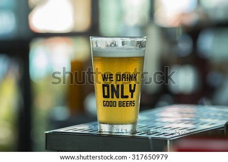 Cold Draught Beer pouring in the the glass - stock photo