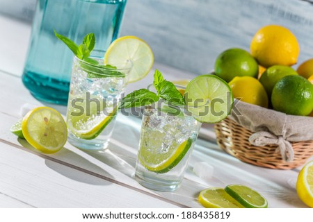 Cold drink made of citrus fruit with sugar - stock photo