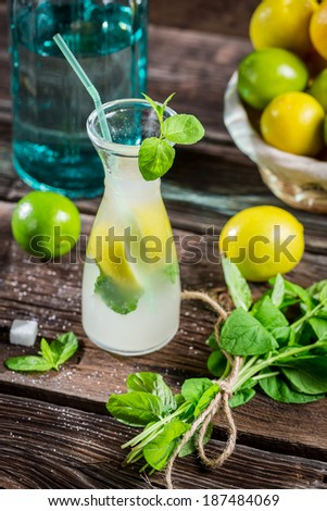 Cold drink with fresh citrus fruit - stock photo
