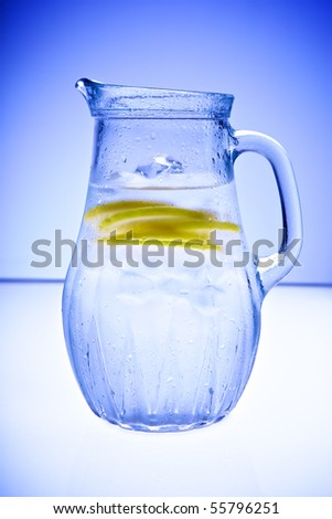 Cold drink with ice and lemon slice - stock photo