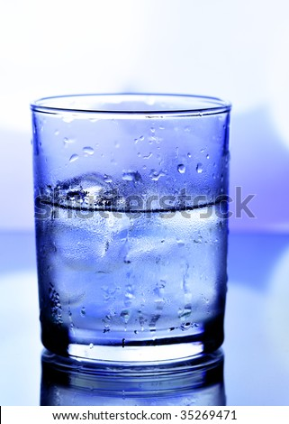 Cold drink with ice cubes close-up - stock photo