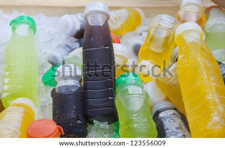 cold drinking fruit juice beverage in ice cooler - stock photo