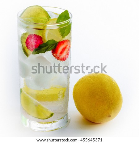 cold fresh cocktail drink lime lemon fruits on white background - stock photo