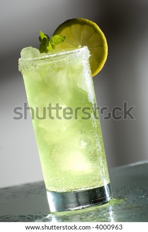 cold fresh cocktail drink with mint close up - stock photo