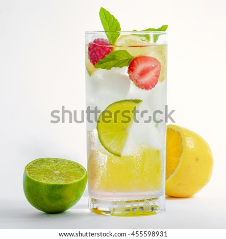 cold fresh cocktail lemonade drink on white background - stock photo