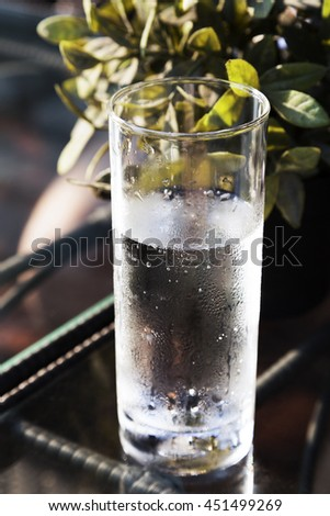Cold fresh drinking water in glass on table