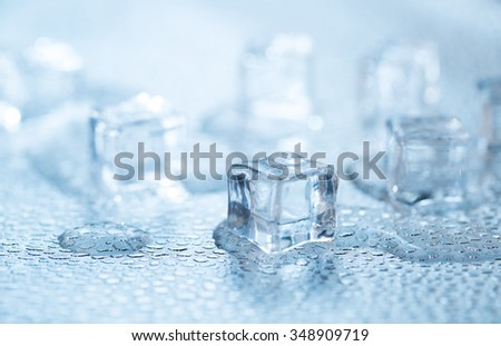 Cold fresh ice cubes with water drops - stock photo