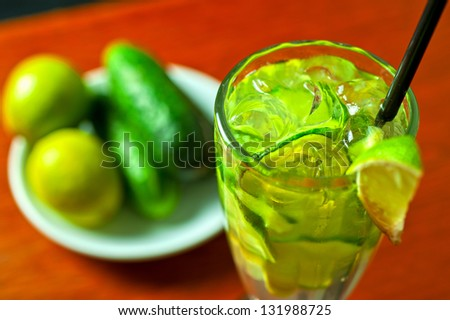 cold fresh lemonade drink with cucumber and lime - stock photo