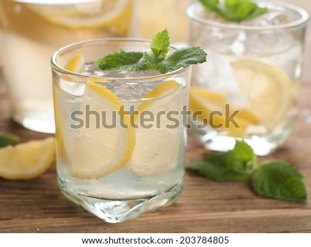 Cold fresh lemonade with lemon, selective focus  - stock photo