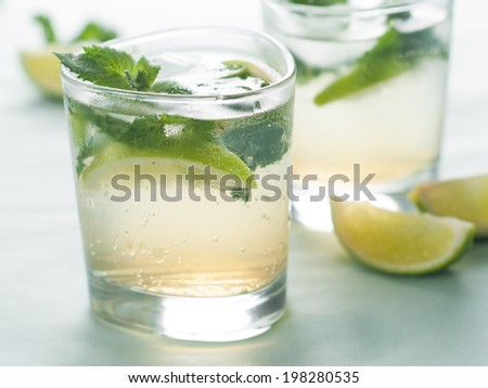 Cold fresh lemonade with lime and mint, selective focus