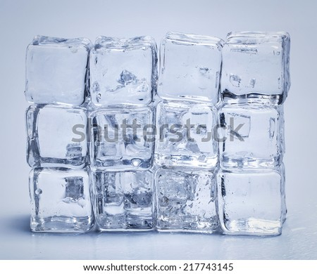 Cold. Frozen ice cubes on the table