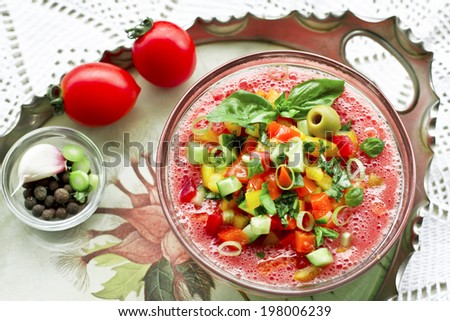 Cold gazpacho with fresh vegetables in glass bowl - stock photo