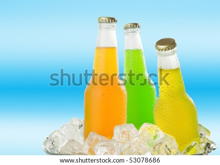 Cold glass beverages in heap of glass cubes