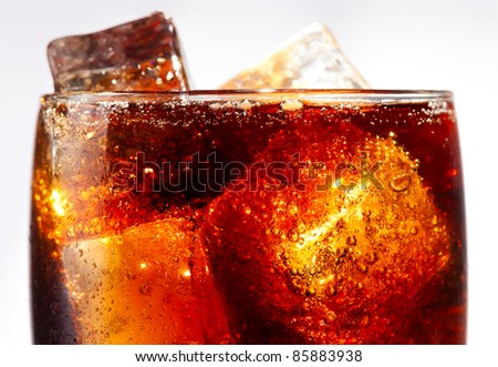 Cold glass of cola close up with ice