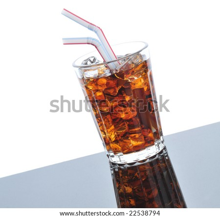 Cold Glass of Cola  with two Straws on gray background with reflections - slanted