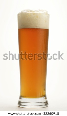 cold glass with beer with white background