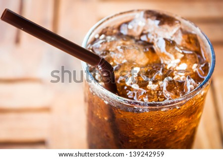 Cold glass with cola and ice cubes - stock photo